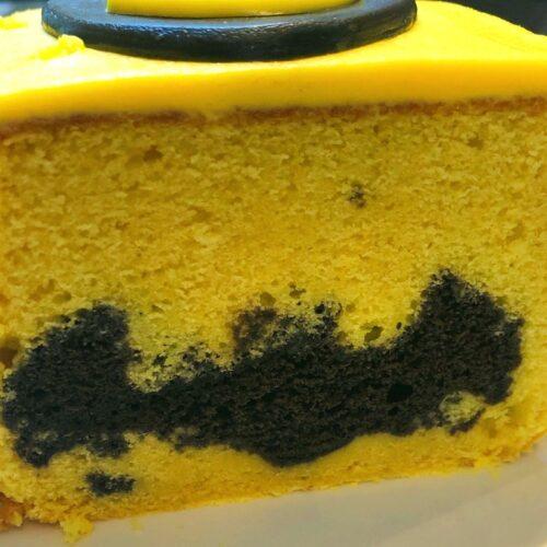 inside of batman cake with chocolate cake bat cutouts