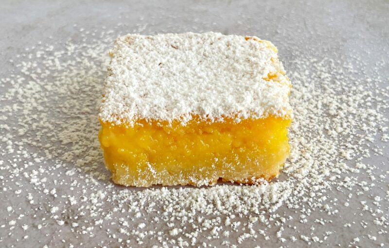 passion fruit bar with powdered sugar on top