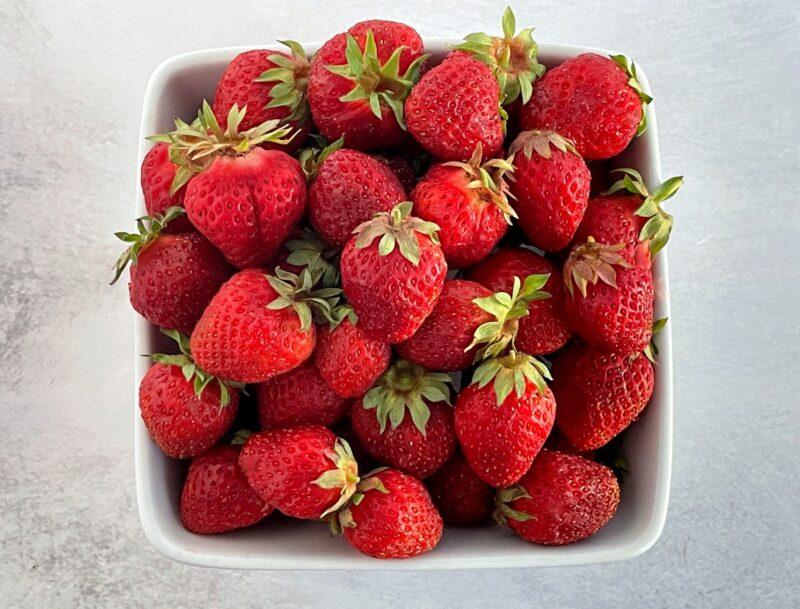 a bowl of fresh hood strawberries