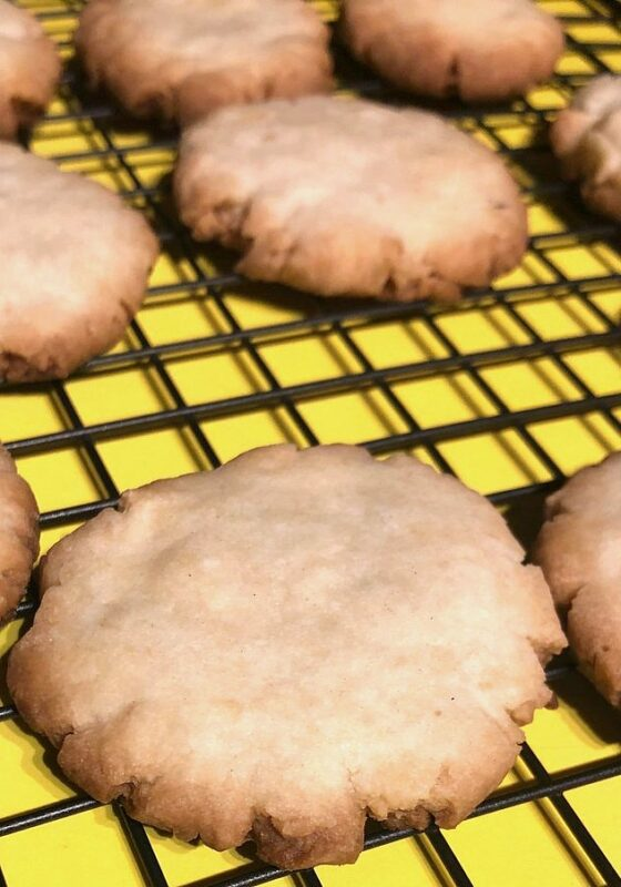baked shortbread cookies on a cooling rack for twix cookie recipe