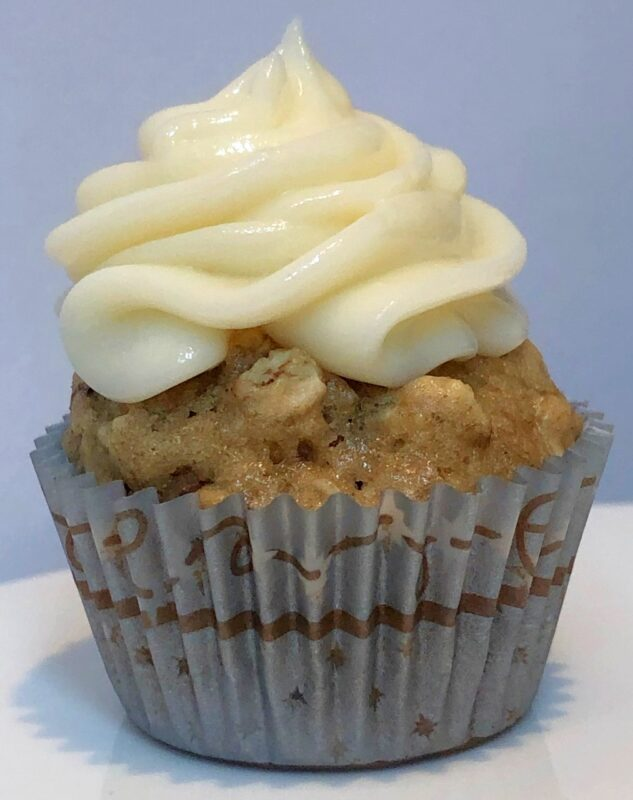 banana oatmeal muffin with cream cheese frosting