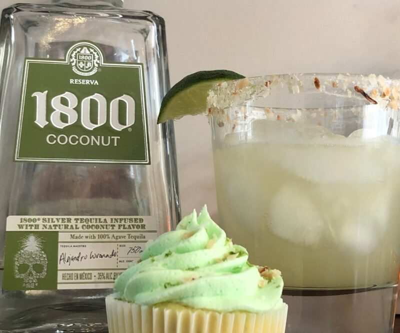 coconut margarita and coconut margarita cupcake next to a bottle of 1800 Coconut Tequila