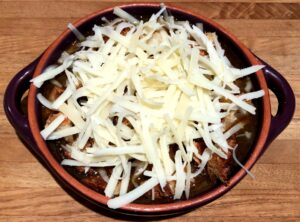 french onion soup with bread and cheese before broiling