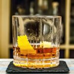 modern negroni cocktail in a low ball with orange peel garnish