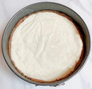 lavender cheesecake in springform pan before baking