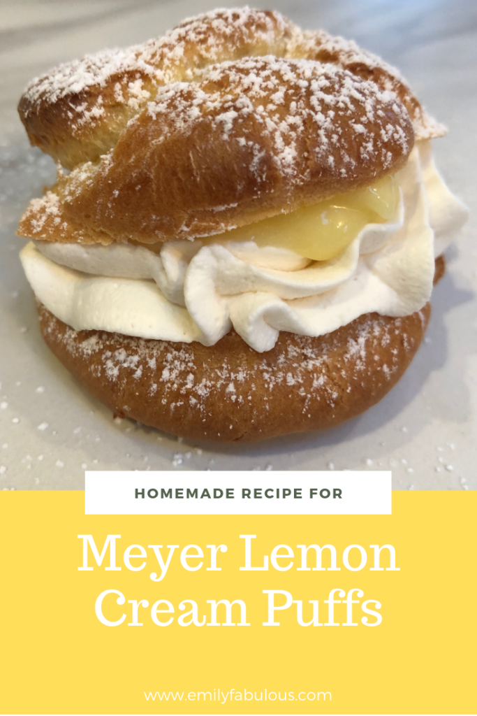 meyer lemon cream puff filled with lemon curd and fresh whipped cream sprinkled with powdered sugar