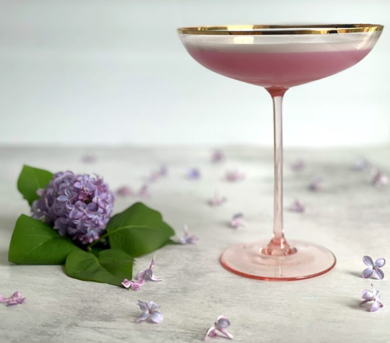lilac beauty cocktail in a coupe glass