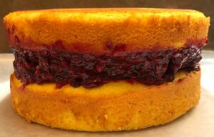 marionberry cake layer with marionberry jam in the middle