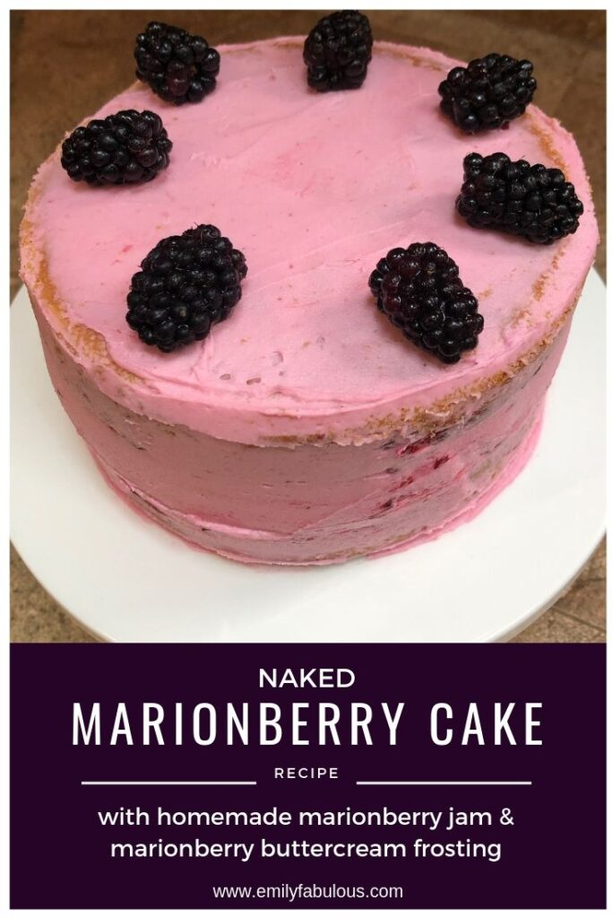 a naked marionberry cake with marionberry buttercream frosting and fresh marionberries on top