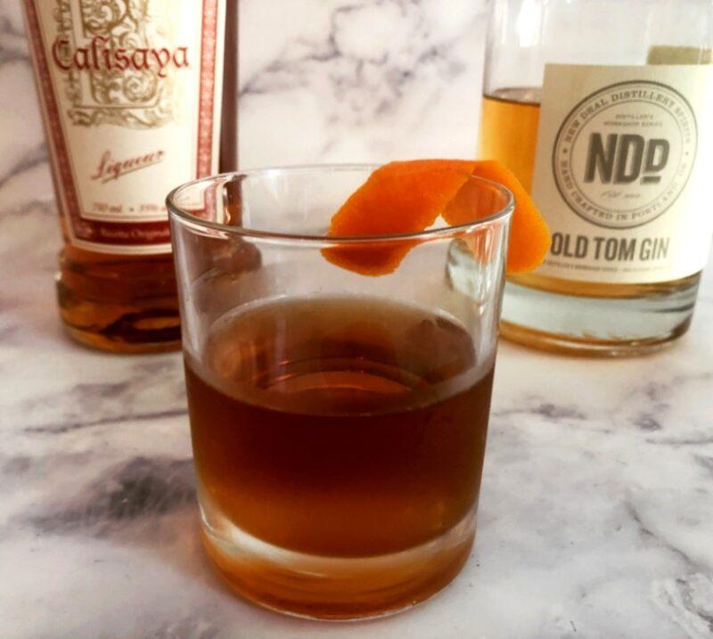 modern negroni with orange peel, old tom gin and calisaya liquor