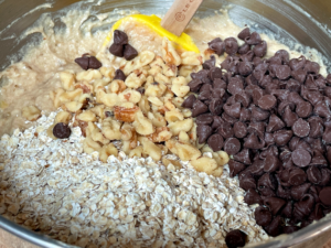 nuts, oats and chocolate chips added to banana oatmeal batter
