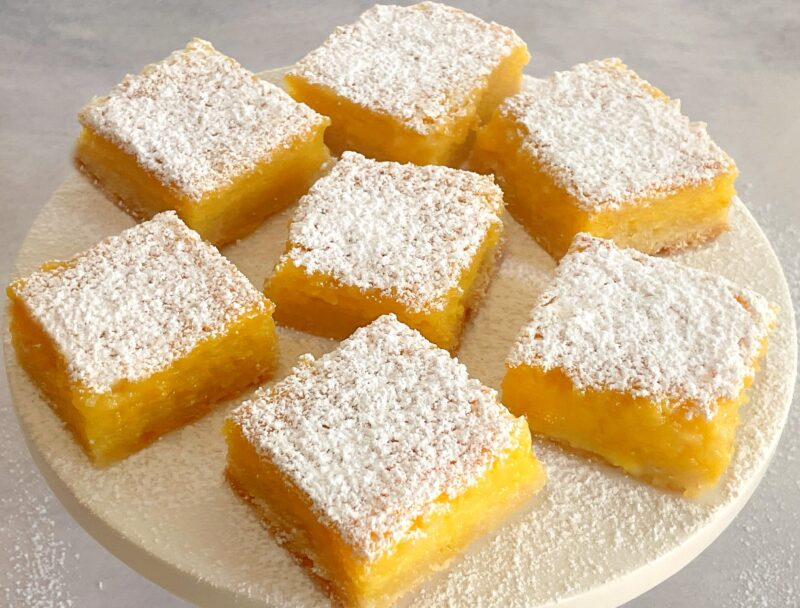passion fruit bars on a cake plate