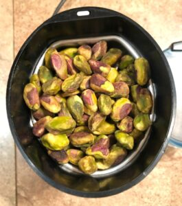 pistachios in small coffee grinder to make pistachio flour or paste