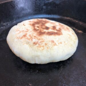 pita cooking on hot pan
