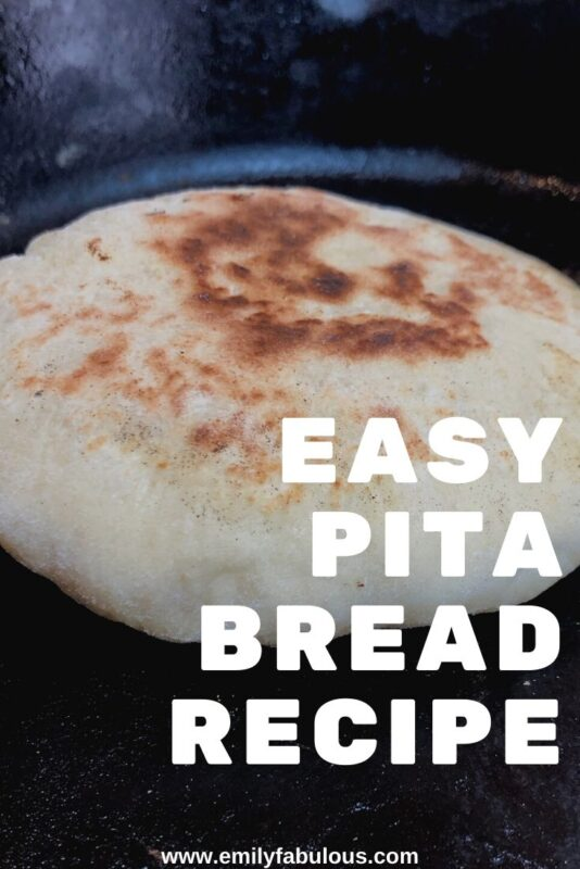 homemade pita bread cooking on a cast pan