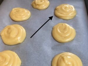 puff pastry piped for baking cream puffs