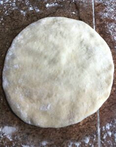 rolled out pita dough