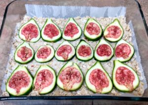 sliced figs on top of coconut fig crumble