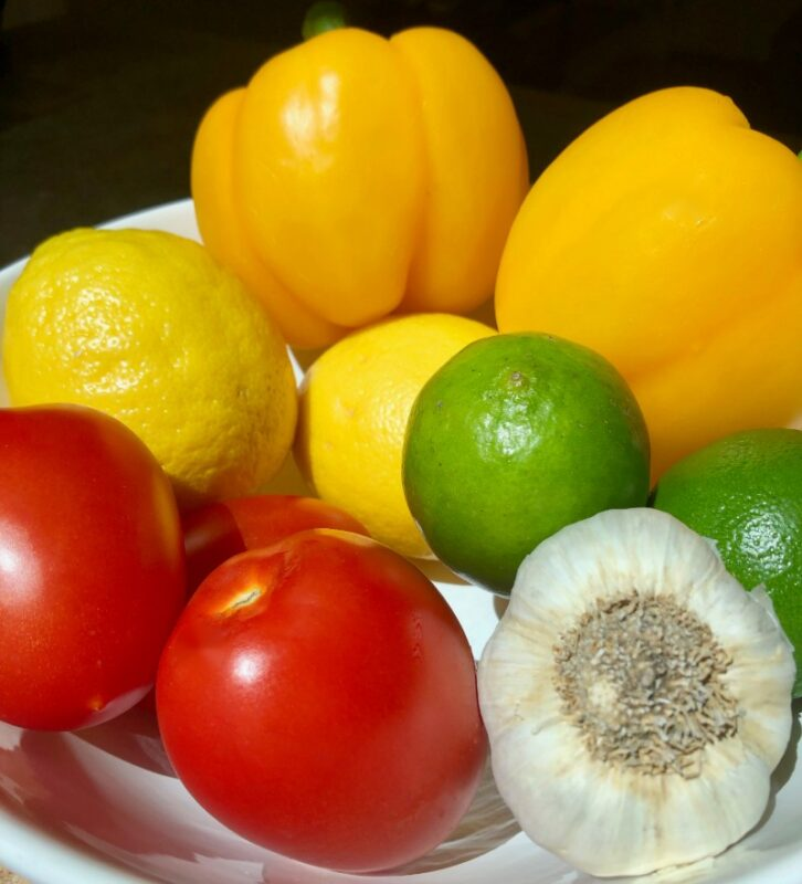 fresh vegetables and fruit in a bowl