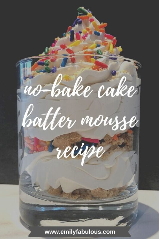 no- bake cake batter mousse swirled in a jar with crushed graham crackers and sprinkles
