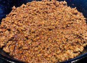 ground beef with taco seasoning in a pan