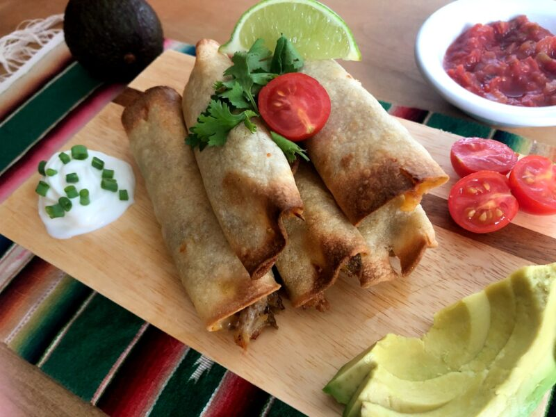 taquitos with garnishes