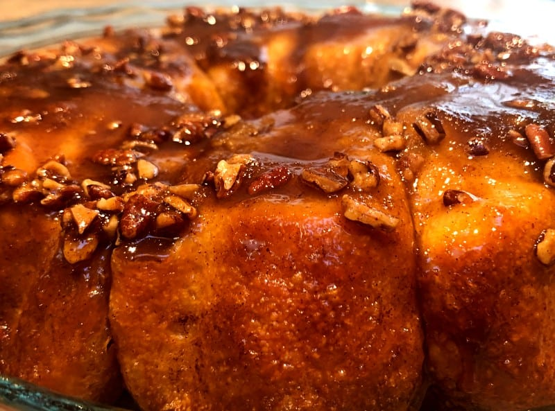 cinnamon pull apart rolls with chopped nuts and a brown sugar glaze