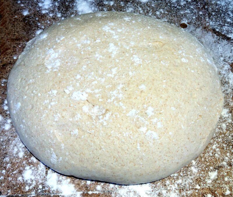pizza dough on a floured counter