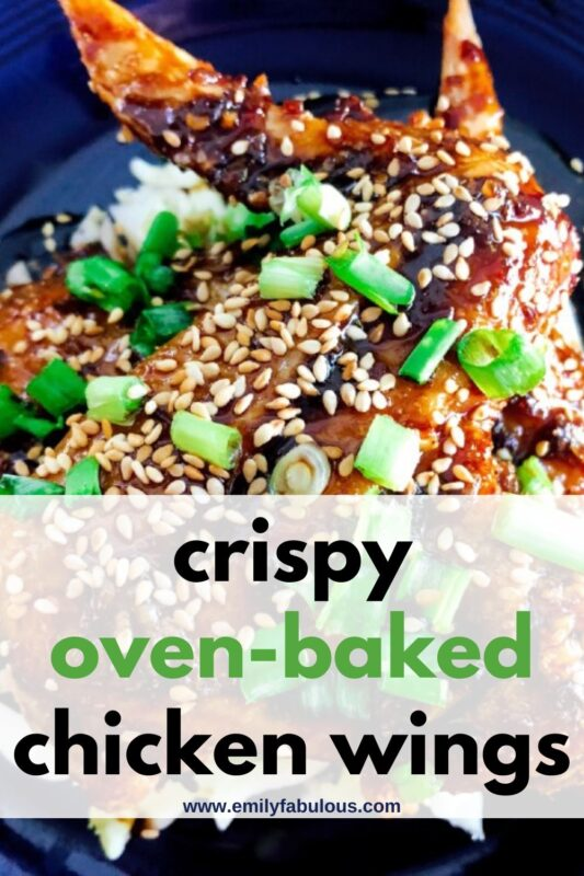 Crispy Baked Asian Chicken Wings on a plate with chopped green onions and baked sesame seeds for garnish