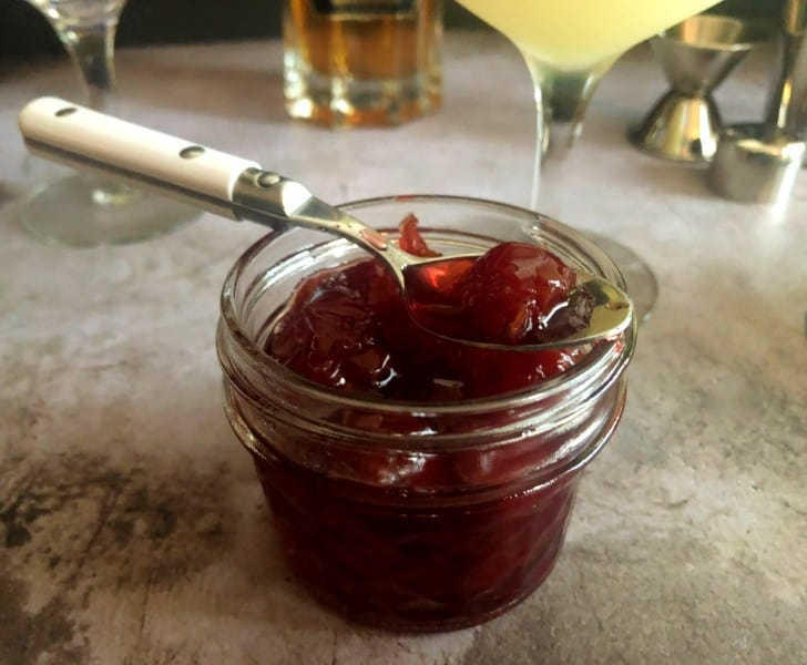 homemade amarena cocktail  cherries in a jar with a spoon
