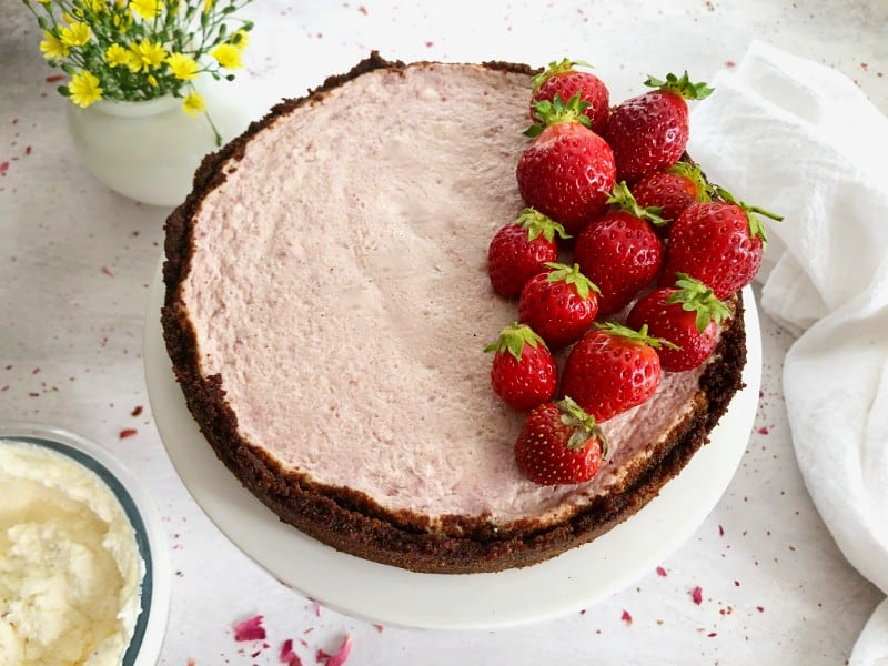 instant pot strawberry cheesecake with fresh strawberries on top