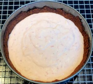 instant pot strawberry cheesecake in pan before baking