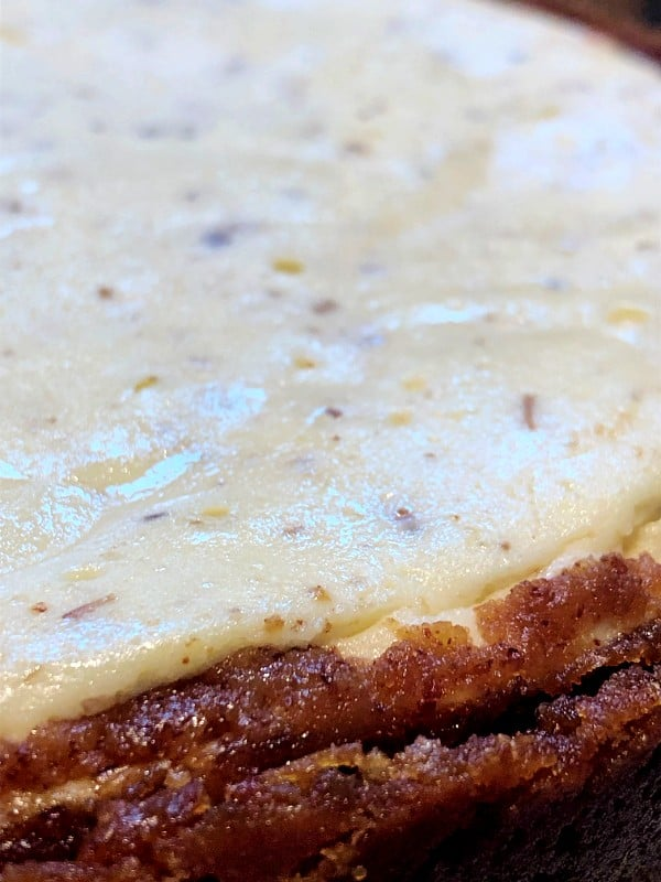 side view of lavender cheesecake and the honey almond crust