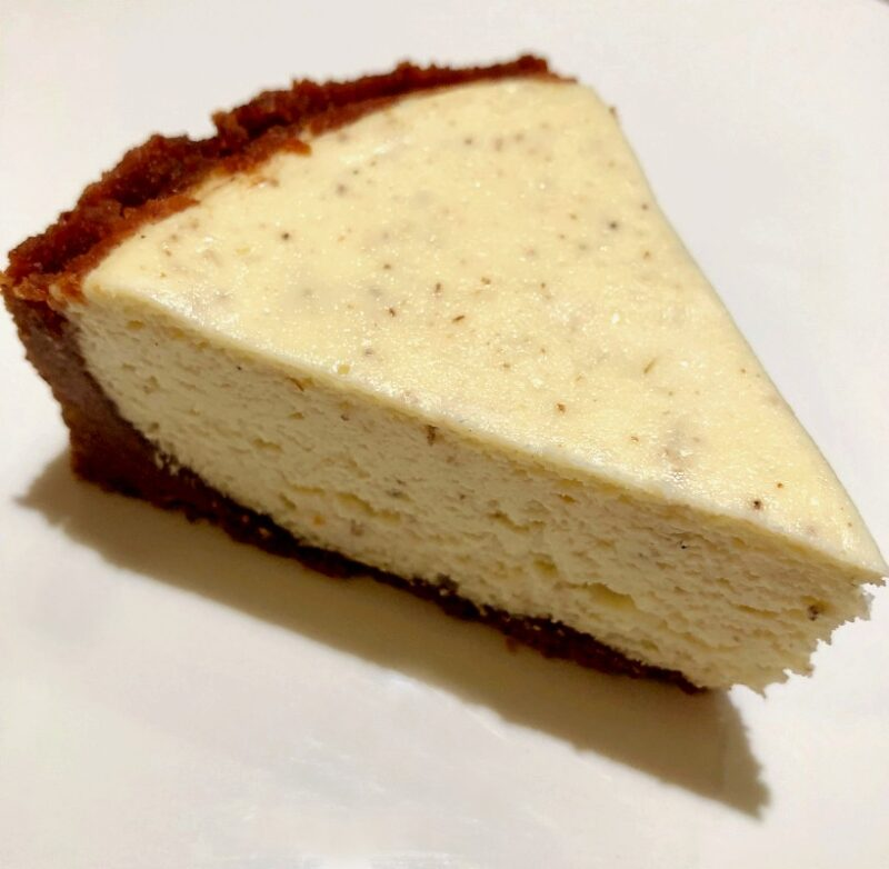 a slice of lavender cheesecake with honey almond crust