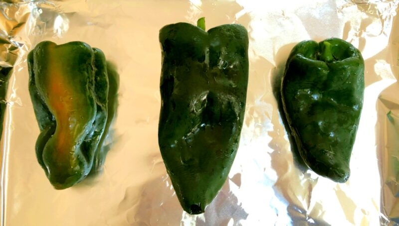 poblano pepper on a baking sheet with tin foil for roasting