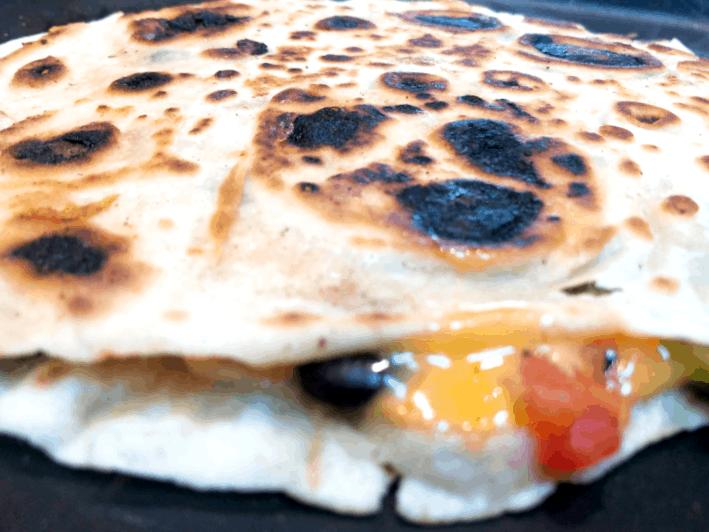 veggie quesadilla cooking on skillet
