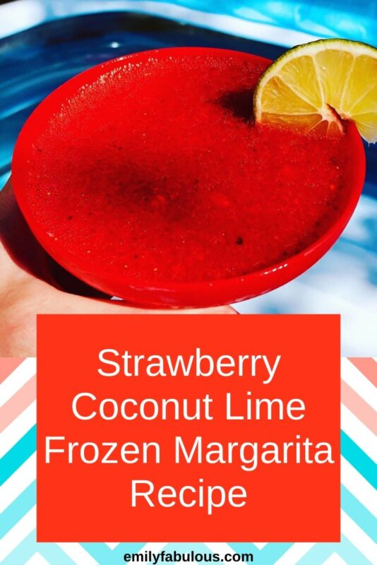 Strawberry Coconut Frozen Margarita with a lime wedge
