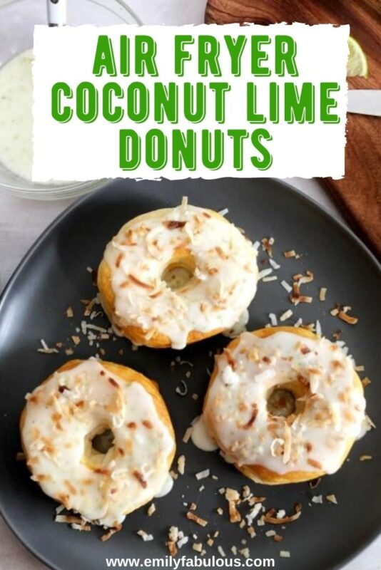 air fryer coconut lime donuts on a plate with glaze and limes on a cutting board
