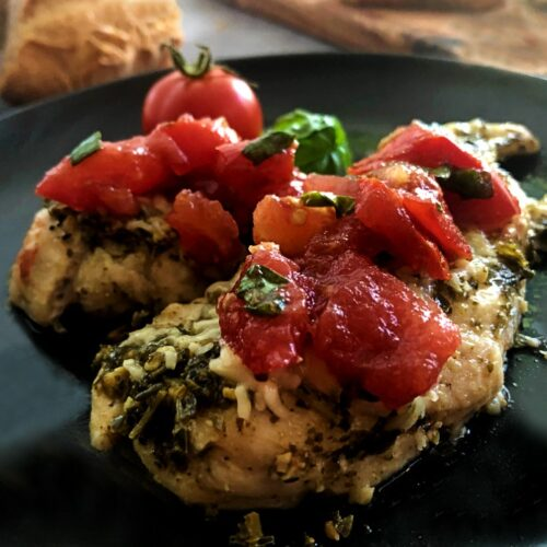 baked pesto chicken with bruschetta on top