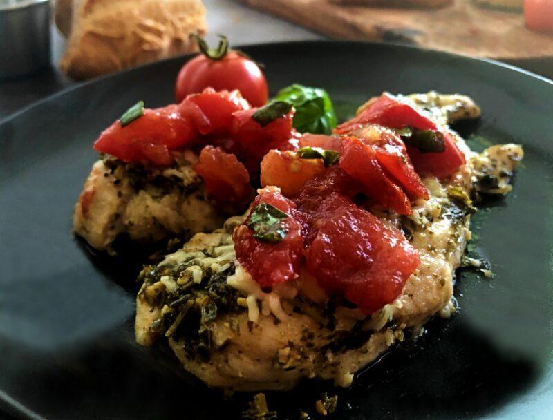 baked pesto chicken with bruschetta on top