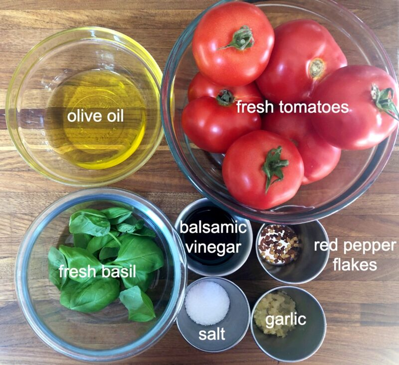 bruschetta ingredients: tomato, olive oil, basil, balsamic vinegar, red pepper, garlic, salt