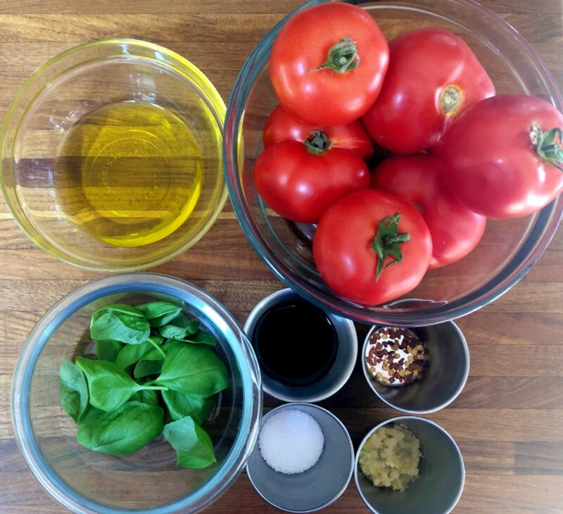bruschetta ingredients: tomatoes, olive oil, garlic, basil, balsamic vinegar, salt, red pepper flakes