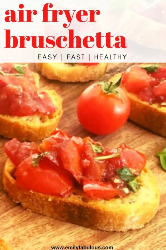 bruschetta on bread toasted in air fryer with a fresh tomato on a cutting board