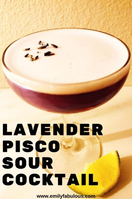 lavender pisco sour cocktail in a glass with a lime slice
