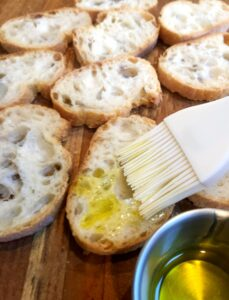 sliced baguette with olive oil brushed on2