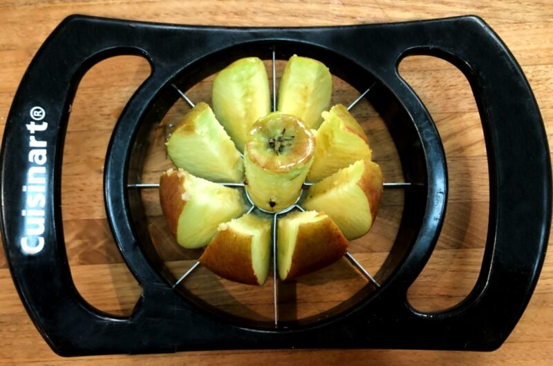 apple corer/slicer slicing an apple