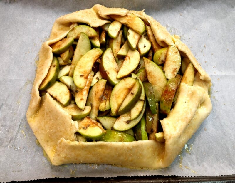 apple lavender galette on parchment paper before baking
