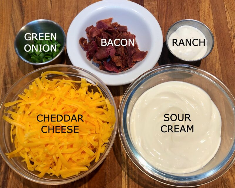 baked potato tater tot ingredients: sour cream, cheddar cheese, bacon, green onion, ranch dressing