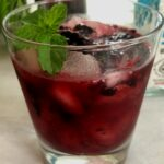 huckleberry cocktail with mint sprig