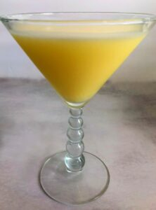 lemon curd cocktail in a martini glass